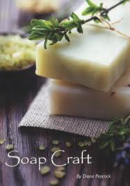 Book cover: a small stack of homemade soap in natural colours, surrounded by herbs
